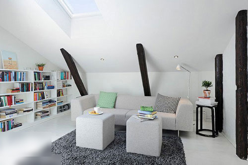 简洁的线条,基础的米白色,与原始砖墙相结合突显出不张扬的时尚品味.